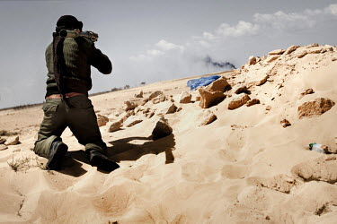 A rebel fighter takes aim with an RPG near the frontline in Ajdabiya. On 17 February 2011 Libya saw the beginnings of a revolution against the 41 year regime of Col Muammar Gaddafi.