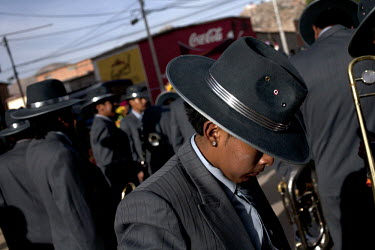 A band prepare to perform at the Carnaval de Oruro. During the fiesta many people sacrifice llamas and give offerings such as coca leaves and cigarettes to show their dedication to the Devil, a Virgin...