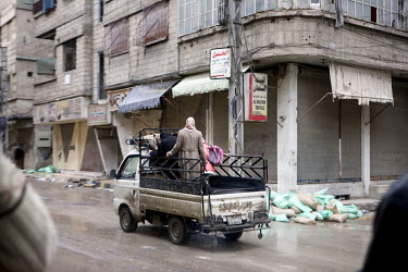 A Family leave the eastern Damscus suburb of Sakba on the back of a pickup truck following an assault by government forces in their attempt to retake the area from the Free Syrian army.Protests agains...