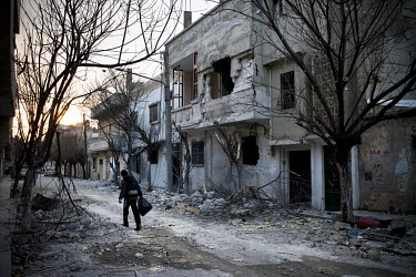 A boy walks amidst destruction in the district of Babr Amr in Homs.Panos photographer William Daniels was caught up in the rocket attack on the temporary media centre in the besieged Syrian city of Ho...