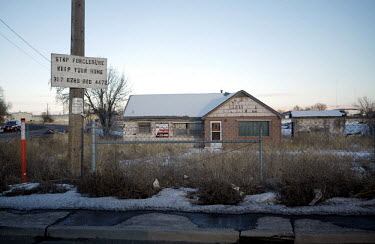 A sign offering homeowners help to fight foreclosures in the small western town of Idaho Falls.