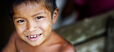 A young boy poses for a photograph in the Kapawi community.