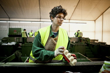 An employee sorts card at an EKON (The Association Disabled for the Environment) recyclable materials sorting facility. The Ekon association employs hundreds of mentally disabled and mentally ill peop...