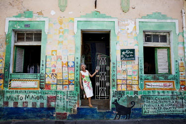 Painter Iza do Amparo poses for a portrait outside her atelier in Olinda.
