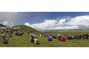 A horse race on the Batan plain in Yushu prefecture. Horse festivals are resurgent since resettlement despite government crackdowns on official gatherings. Natural and cultural resources are a valuabl...
