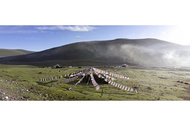 Traditional black yak-hair tents in an unusually close density to provide protection from cattle rustlers who may attack nomadic families near main roads, such as the main route to Yushu town nearby.S...