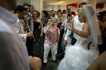A famous Gipsy singer performs at a wedding in the village of Certeze. The villagers called this event 'the wedding of the year' since the bride was the daughter of one of the richest men in the villa...