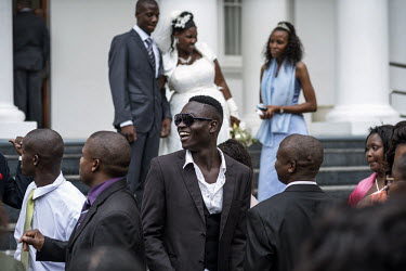 People attend a wedding at a chapel in central Maputo.