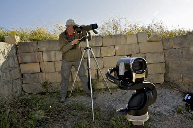 Steve Miller, from the UK, scans the horizon looking for migrating raptors. Under EU leglislation, hunting or trapping birds in spring is illegal but the government of Malta, which joined the EU in 20...