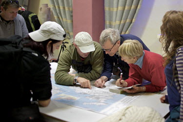 Inside the basement of the Bella Vista Hotel volunteers familiarise themselves with the island's geography before an afternoon shift of monitoring. Under EU leglislation, hunting or trapping birds in...