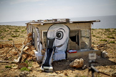 Art produced by artist Lucy McLauchlan of the collective 'Ghost of Gone Birds' on a hunter's hide. The images are of herons, spoonbill and turtle doves.Under EU leglislation, hunting or trapping birds...