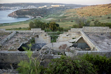 Derelict buildings on a hill top provide a good vantage point across valleys where hunters shoot birds. This building is used by volunteers with Spring Watch Malta to check on migrating birds and look...