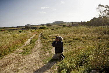 Har Pluijmakers, 61, from the Netherlands keeps watch for migrating species.Under EU leglislation, hunting or trapping birds in spring is illegal but the government of Malta, which joined the EU in 20...
