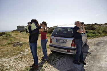 Volunteers with Spring Watch Malta scan across a landscape with binoculars during a morning shift, looking for migrating birds and hunters who are targeting the birds illegally. Under EU leglislation,...