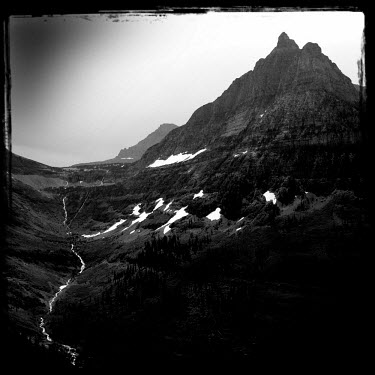 A landscape with rocky peaks in the Glacier National Park.