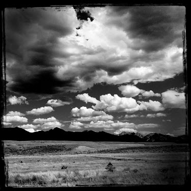 Clouds drift over a barren landscape in Montana.