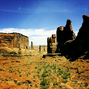 An arid landscape with rock formations in the Arches National Park.
