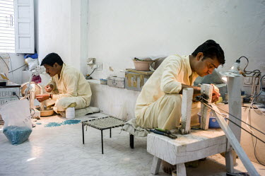 Workers making fine jewellery in the workshop at The Gem Palace in Jaipur.