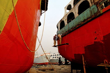 Labourers work on the construction of a ship at a ship building yard in Dhaka. Workers get around 300 Tk (about GBP 2.45) per day for working at the yard.