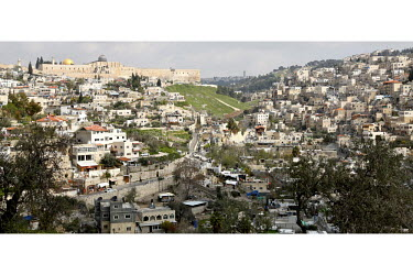 Jerusalem's Old City Wall, crowned by the golden Dome of the Rock and the Al-Aqsa mosque, hovers over Silwan, a densely populated East Jerusalem neighbourhood where children are affected by deep pover...