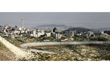 East Jerusalem's Shufat Refugee Camp, the only refugee camp in Jerusalem, is located two kilometers from the Old City but separated from the town by the Barrier and a checkpoint. Its residents can cro...