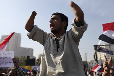 A man, with a double wrist disarticulation (amputation), shouts during a demonstration in Tahrir Square against President Mohamed Mursi (Morsi) and the Islamist-led assembly. Thousands of people gathe...