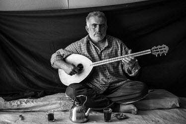 Omar (name changed to protect his identity), 37, inside his tent in the Domiz refugee camp in the Kurdistan Region of Iraq on 16 November 2012. Omar decided it was time to flee his home in the Syrian...