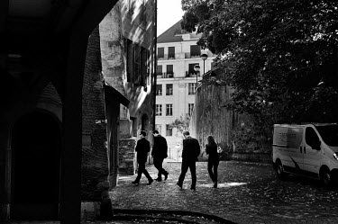 Private bank employees walking through the Old Town.