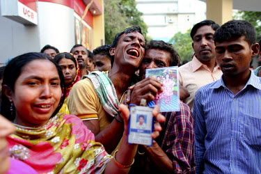 Relatives of dead and missing garment workers mourn and wail outside the collapsed Rana Plaza complex in Savar, holding up pictures of their loved ones. The 8 storey building, which housed a number of...