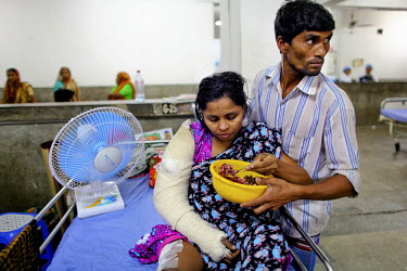 25 year old Morium is helped by her husband to eat. She has an injured leg and arm. She is one of the survivors of the collapsed Rana Plaza complex. She was worried about the cracks in the wall at the...