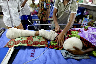 Rebeka, 20, was rescued after two nights from inside the collapsed Rana Plaza complex in Savar. She had one of her dead colleagues lying on top of her and was fed water through a hole in the wreckage....