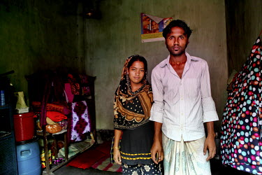 A newly married couple in their small room in a poor neighbourhood of Dhaka. They are both textile workers.