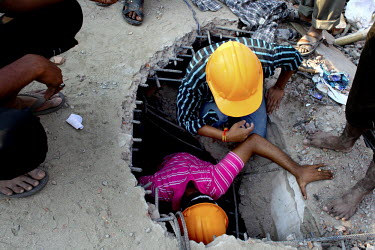 Rescue teams search for survivors in the ruins of the collapsed Rana Plaza complex on the outskirts of Dhaka.The 8 storey Rana Plaza complex, which housed a number of garment factories employing over...