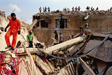 Rescue teams search for survivors in the ruins of the collapsed Rana Plaza complex in Savar.The 8 storey Rana Plaza complex, which housed a number of garment factories employing over 3,000 workers, co...