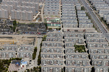 Identical rows of housing and apartments blocks in the city of Jiangyin.