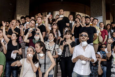 Bystanders and hotel guests shout at the police from the steps of a hotel near the planned construction site at Gezi Park as rounds of tear gas canisters are fired by police at protesters. Protests ag...