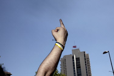 A protester in the Osmanbey district of Istanbul (about 1km from Gezi Park) gives the middle finger to a police helicopter as it circles above a crowd  anti government protesters. Protests against the...