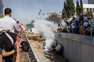 A tear gas canister lands in the construction site of the propsed shopping complex and mosque in the Gezi Park area of Istanbul as thousands of protesters attempt to get to the area.Protests against t...