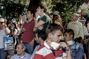 Protesters gather at a corner of Gezi Park and watch as riot police approach the area. Protests against the government of Recep Tayyip Erdogan spread across Turkey after a peaceful sit in organised by...