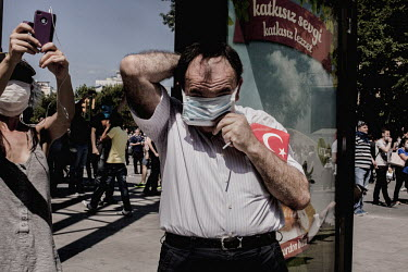 A man prepares to confront riot police in the Osmanbey district of Istanbul at the beginning of the anti government protests.�Protests against the government of Recep Tayyip Erdogan spread across Turk...