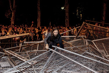 An anti government protester attempts to build a barricade to stop the riot police from advancing in the Besiktas area of Istanbul. Protests against the government of Recep Tayyip Erdogan spread acros...