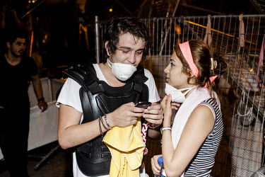 A couple who have just retreated from being tear gassed by police share a moment before adding their pictures to social networks by mobile phone in the Besiktas area of istanbul.�Protests against the...