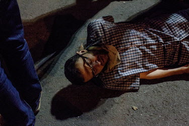 A protester in the Besiktas area of Istanbul collapses from tear gas fumes fired by riot police during a protest. Protests against the government of Recep Tayyip Erdogan spread across Turkey after a p...