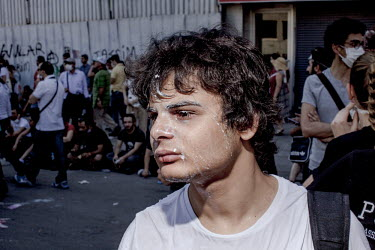 A young protester recovers from the effects of tear gas during a demonstration against the government of Recep Tayyip Erdogan and his AK Party in the Sisli area of Istanbul. Protests against the gover...