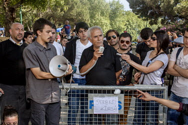 Protesters gather around a speaker with a megaphone during a demonstration at Gezi Park in Istanbul. Protests against the government of Recep Tayyip Erdogan spread across Turkey after a peaceful sit i...