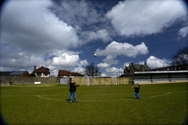 Tim Richards, the Chairman of Sheffield FC, and his son play with a ball at the ground of Hallam FC (est. 1860), located in a leafy suburb of Sheffield, South Yorkshire. The site, Sandygate Road, is o...