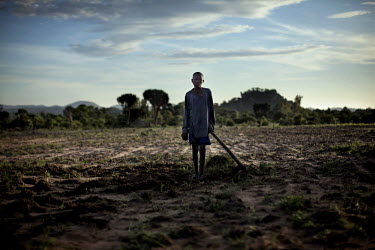16 year old orphan Andrew hoes a field in preparation for sewing crops. Many parts of Zimbabwe have suffered from sever drought this year. UNICEF has warned that as many as 3.5 million vulnerable chil...