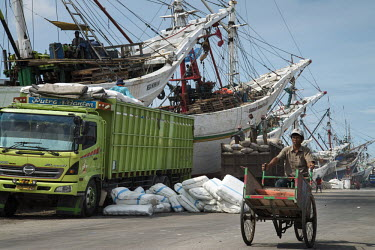 Sacks of cargo await loading and unloading onto Makasar Schooners moored in the old port of Sunda Kelapa.