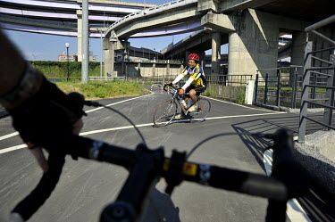 A rider's view of the cycle route along the Xindian River in the Yonghe suburb of Taipei.