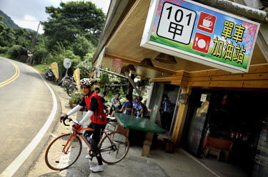 A rider prepares to depart from a popular cafe on a climb up the northern side of Yangminshan, the dormant volcano that dominates North Taiwan, just an hour by bike from downtown Taipei.